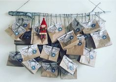 Adventskalender-Ideen: Säckchen aufgehängt an einem Ast Bild via Instagram, kristine.behmane.