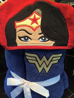 A personal favorite from my Etsy shop https://www.etsy.com/listing/258263218/wonder-woman-inspired-hooded-bath-towel