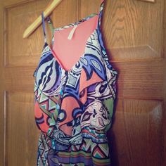 Patterned Sun Dress Patterned dress with zipper in front. 100% polyester. Dresses