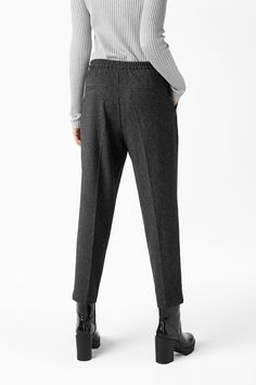 <p>Dressy trousers that are meant to have a casual-chic, slightly oversize fit. An elasticized waist in back keeps things in order. Slant pockets in f