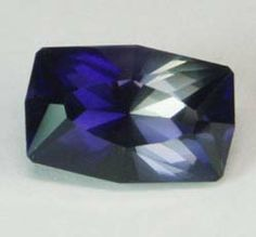 D&J Rare Gems - Beautiful Iolite Dk Blue/Purplish Gray, 6.52 cts split sided brilliant cut measuring 14.2x9.4x8.1 mm, eye clean, from Tanzania. A larger, eye clean iolite that displays an interesting combination of dichroic colors due to the cut. One side is a deep, intense blue while the other side is a purplish gray. This color combination is the result of cutting the gem off the perpendicular axis of its pleochroic colors