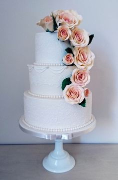 Classic Rose Cascade. elegant lace. Beautiful Wedding Cakes made to order in Swansea and South Wales. Custom made design to your specific needs. Looking elegant and tasting delicious. Please contact me with any questions or to arrange a consultation.