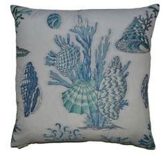 Rich, embroidered details make up these incredible under-the-sea coastal pillows splashed with blue and aqua tropical shells and coral images on an ivory background.