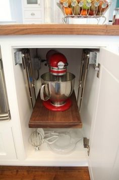 Pop up mixing stand. Note: avoid if machine shakes while running on high speed.  Notice the electrical outlet inside the cabinet.