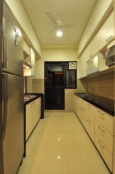 Parallel Kitchen With Modular Cabinets by Mahesh Nagari Kitchen Wood Design, Parallel Kitchen Design, Kitchen Cupboard Designs, Interior Design Kitchen, Kitchen Modular, Home Room Design, Kitchenettes, Interiors, Bedroom