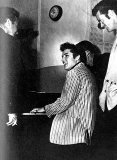 Elvis playing piano for his first recording session on the movie set Jailhouse rock april 30 1957 .