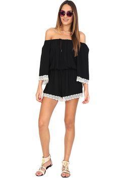 Black off-the-shoulders romper featuring white crochet detailing at the hem and sleeves, front drawstring closure and keyhole, synched waist, and bell sleeves. This gorgeous romper is perfect for festival season! Pair with fringe sandals and get your boho on!