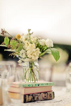 Mason jar flowers on top of books