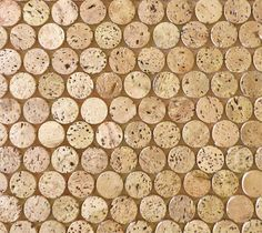 CorkDotz - Brown Mosaic Tile - CorkDotz Mosaic is a forward-looking recycled tile. Created from the cork stopper industry's by-product, this 1x1 Cork Penny Round is perfect as kitchen backsplash tile, floor tile, bathroom tile and even ceiling tile. Our Cork Penny Round Tile is water resistant once sealed per the installation instructions. CorkDotz are priced by the square foot but shipped in sheets that are larger than a square foot for ease of installation. To determine the quantity…