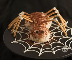 Never has an appetizer been so sweet and so scary at the same time. What a tangled web you weave, when you make a spider from cream cheese!
