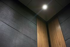 LEVELe-102 Elevator Interior with customized panel layout; Capture panels in Bonded Aluminum with Dark Patina and Charleston pattern, and American Walnut wood veneer; ceiling in Stainless Steel with Sandstone finish at Twelve | Twelve, Nashville, Tennessee