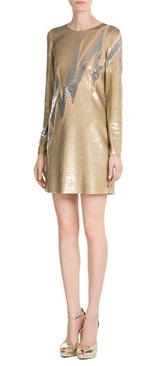 In matte gold with a flash of silver, this sequin covered dress is typical of Emilio Pucci's statement aesthetic. The high hemline adds youthful cool, with long sleeves for a chic finish #Stylebop