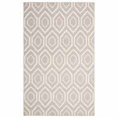Anchor your dining room or master suite in chic style with this flatweave wool rug, showcasing a geometric motif in grey and ivory.  Product: RugConstruction Material: WoolColor: Grey and ivoryFeatures:  FlatwovenGeometric motifNote: Please be aware that actual colors may vary from those shown on your screen. Accent rugs may also not show the entire pattern that the corresponding area rugs have.Cleaning and Care: Professional cleaning recommended