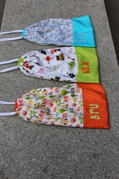How about making toy bags with children's names or names of toys machine embroidered on them?