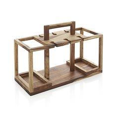 Shop Wine Bottle and Glass Caddy.  Beautiful sheesham wood caddy is ready when you are, tidying up the bar with storage for four bottles of wine and racks for up to six wine glasses.