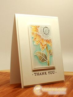 ilinacrouse Vellum Sunflower. The image is heat embossed on the front of the vellum then colored on the back.