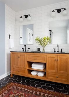 Large format subway tile was installed to the ceiling around the vanity to create visual drama and a clean backdrop. Old Bathrooms, Upstairs Bathrooms, Downstairs Bathroom, Small Bathroom, Bathroom Ideas, 1920s Bathroom, Lake Bathroom, Mermaid Bathroom, Attic Bathroom