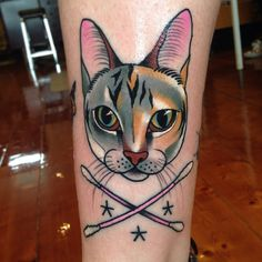 """Rhiannon's cat with cotton buds (""""Q-Tips"""" for you American folk out there)…"""