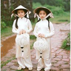 Vietnam. Sweet lantern girls holding traditional lanterns.