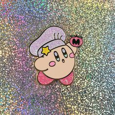 ❤Chef Kirby❤ This pin features our favorite pink puffball getting ready to whip up a delicious snack! • Hard enamel • 1.25 Inches • Double Posted on the back, for the perfect placement! • PINK Rubber Clutches on the back! • Gold Metal, featuring Glitter! ❤This pin is adorable!, the