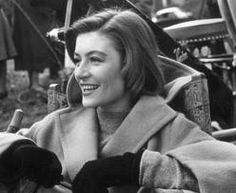 French actor Anouk Aimee, wearing a camel-hair overcoat and gloves, laughs while sitting in a folding chair on a film set. Get premium, high resolution news photos at Getty Images Anouk Aimée, Stephane Audran, Jacques Demy, Bernardo Bertolucci, Nostalgia, Film World, French Films, French Actress, Cinematography