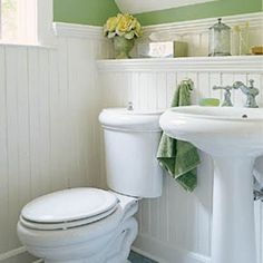 I'm a fan of wainscoting in bathrooms...I'm thinking it might be good for when we totally redo one of the bathrooms in our pending house. We already have a Cape Cod-ish theme to our bathroom stuff and I think it goes well.