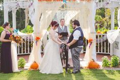 rustic fall autumn October central florida wedding great dane dog as ring bearer gazebo decorated with pumpkins and diy tulle and silk flowers. maid of honor in plum bridesmaidvdress. casablanca bride.