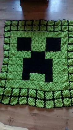 Minecraft large creeper blanket I made using granny squares for my son.minecraft madness