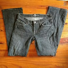 Dark wash 7 for all mankind jeans Excellent condition. Size 26- measures 27 inches in the waist. Inseam measures 28 inches. No fraying at bottom and minimal signs of wear. 98% cotton and 2% polyurethane. 7 for all Mankind Jeans Boot Cut