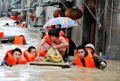 Rescuers evacuate residents from floodwaters brought on by typhoon Megi in Ningde, eastern China's F... - AFP/Getty Images