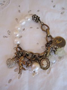 vintage repurposed jewelry charm bracelet pave heart cupid aquarius baroque pearl aquamarine butterfly clasp valentines gift via Etsy Recycled Jewelry, Old Jewelry, Charm Jewelry, Jewelry Crafts, Vintage Jewelry, Beaded Jewelry, Handmade Jewelry, Jewelry Making, Charm Bracelets