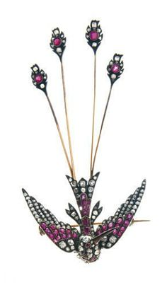 AN ANTIQUE DIAMOND AND RUBY SWALLOW BROOCH   Designed as a rose and old mine-cut diamond and cushion-cut ruby swallow, Circa 1860.