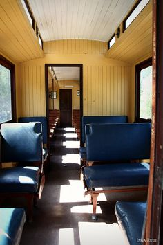 The way the inside seating of a train car looked way back when.