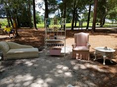 Mimosa bar with chaise lounge and pink and white striped chair for outdoor wedding