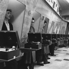 Soundproof listening booth at a London music store, 1955