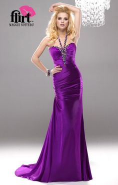 Flirt PF4148 will make you look and feel like a hollywood celebrity! This long sexy sleek gown hugs the hips and has a sweep style train in the back. The halter bodice has straps and a neckline that is graced with large multi colored crystals. The satin material flows ever so perfectly over the figure and offers a truly graceful vibe.