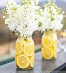Lemon w/ white flowers in mason jar.  Possibly with purple flowers and limes?
