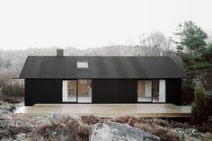 1950s Swedish Island Cottage Locks Out the Elements with a Black Pine Tar Facade | Inhabitat - Sustainable Design Innovation, Eco Architectu...