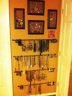 I had to find a way to store all of my jewelry finds from NYC. I added cork board tiles to picture frames to hang my rings and earrings.  I grouped my earrings together with buttons and a straight pin.  I used cafe rods to hang my necklaces. I am able to place all of my bracelets on the outside of the cafe rods.