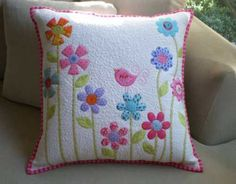 This pattern uses fusible raw edge applique and the pillow top has been machine quilted. The pillow is secured with two large self covered buttons, alterna