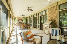 Spacious Back Porch | Brick Fireplace | Built In Barbeque Grill | Outdoor Dining | Luxury Real Estate Bluffton, South Carolina