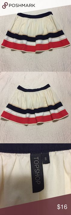"""Cute Topshop Skirt US Size 8 Euro Size 36 Topshop skirt. Great condition. Size 8. Colors: off white, navy blue and red. Laying flat from top to bottom it measures 15.5"""". Topshop Skirts Mini"""
