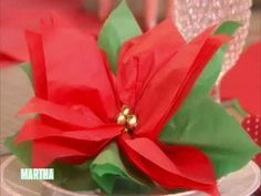 Martha Stewart makes a beautiful poinsettia holiday favor using tissue paper, chocolate covered cheerios, jingle bells, and a leaf template. These are so pretty and easy to make