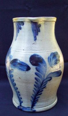 "Remmey Stoneware Pitcher     Imposing two gallon stoneware pitcher attributed the Richard C. Remmey factory of Philadelphia. Excellent contrast between the blue cobalt floral swag decoration and the grey salt-glazed clay. Height - 13""."