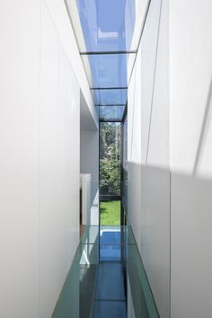 Narrow slices of glazing break up the plain white facade of this residential extension in west London