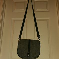"""Harris Tweed Crossbody Purse Harris Tweed is a classic staple for any wardrobe.    This bag has been used twice, and is in excellent used condition.  The interior features one zip pocket and one phone holder.  When purse flap is opened, there is a zipper for added security of your items. 3-1/2"""" deep.  9"""" tall, 10-1/4"""" wide Harris Tweed Bags Crossbody Bags"""