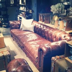 Aged, antiqued, leather tufted couch.