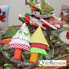 As pictured in AQR's October article Holiday Glam by Anna Woodward, we compiled step-by-step instructions, complete with photos, for fat quarter Christmas trees and stars pictured in the article. T…