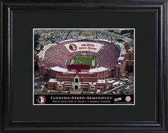 College Stadium Print with Wood Frame - Florida State. Proclaim him/her the star of the show with our personalized College Stadium print. Each print features the image of a beloved college sports venue, with the crowds in the stands paying clever homage to your favorite sports fan via a personalized message. The text at the bottom also includes the name of the recipient and proclaims an official day in his or her honor. Framed in black, it's a handsome addition to any wall. Makes an ideal…