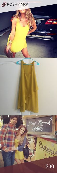 Yellow flowy dress! As seen on Jessie James decker! Super cute flowy dress! Does have small oil stain on the bottom.. Hardly noticeable! silence + noise Dresses Mini